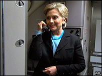 Hillary Clinton speaks to the media on board her campaign plane on 16 January 2008