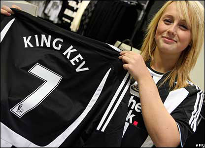 A Newcastle United club shop worker with a Keegan shirt