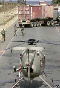 Military helicopter in front of trucks blocking the road in western Kenya