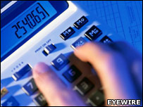 Fingers hovering over a calculator