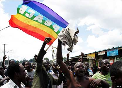 Protestors fly a peace flag in the Nairobi slum of Kibera