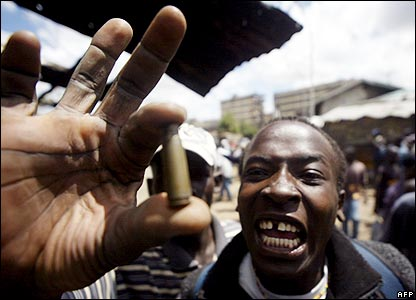 A man holds up bullet casings they say were fired at protesters in the Nairobi slum of Mathare
