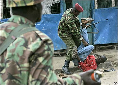 Police beat a demonstrator in Nairobi