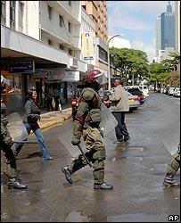 Riot police patrolling Nairobi