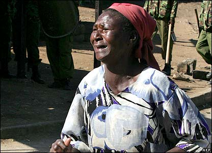 A woman cries after hearing her son was killed in Nairobi