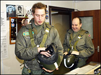 Prince William (L) and Sdn Ldr Roger Bousfield, preparing for take off on 17 January 2008