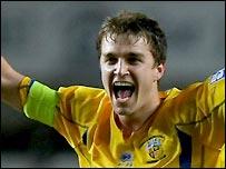 Skipper Jamie Collins celebrates the 1-1 draw at Swansea