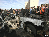 The burnt out remains of a car hit by an Israeli air strike on Thursday in the Gaza town of Beit Lahiya, killing a Palestinian militant commander and his wife