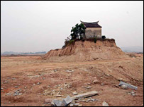A temple in Kunyao, on land prepared for the site of the plant