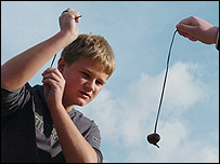 Boy playing conkers