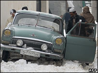 A man pushes a car in the snow in Kabul (Photo: Massoud Hossaini/AFP/Getty Images)
