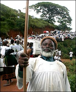 A man holding a Zulu fighting stick