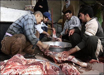 Men cutting meat in Najaf 18/1/08