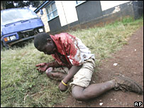 A man in Nairobi's Kibera slum collapses after being shot in the face on 18 January 2008