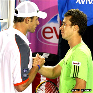 Philipp Kohlschreiber (right) shakes hands with Andy Roddick