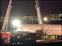 Crane preparing to lift plane