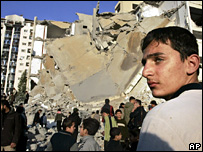 A Palestinian looks at the bombed interior ministry headquarters in Gaza City