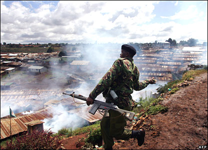 Police officer lobs tear gas in Kibera slum, Nairobi, on Friday 18 January