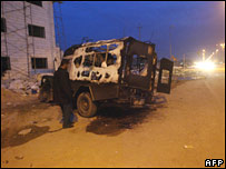 Burned-out Iraqi army emergency vehicle in Basra after Friday's clashes