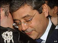 Sicily's governor Salvatore Cuffaro is hugged by his lawyer in court in Palermo