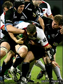Andy Farrell takes on three Glasgow defenders