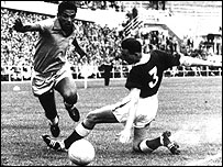 Garrincha takes on Wales' Mel Hopkins at the 1958 World Cup