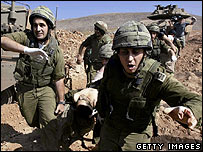 Israeli soldiers with a casualty during the 2006 war