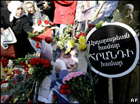 People lay flowers near a picture of Hrant Dink in Istanbul (19 January 2008)