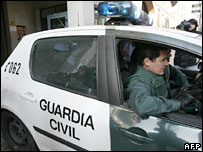 Spanish police with one of the suspects - 19/1/08