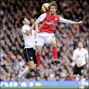 Arsenal's Mathieu Flamini rises above Seol Ki-Hyeon a