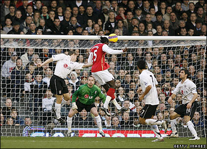 Adebayor rises above the Fulham defence to score his second