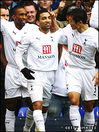 Aaron Lennon, centre, celebrates his early strike at White Hart Lane