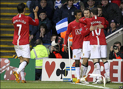 Rooney is congratulated by his Man Utd team-mates