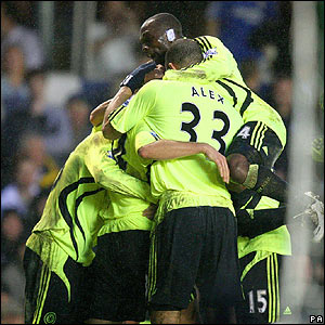 Claudio Pizarro is mobbed by his Chelsea team-mates after scoring the winner