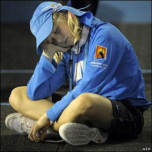 A ballgirl nods off late on Saturday at the Australian Open