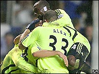 Chelsea players engulf Claudio Pizarro after his winner against Birmingham