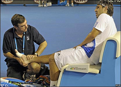Marcos Baghdatis receives treatment