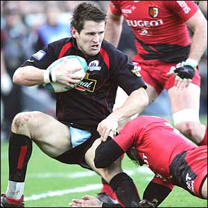 Edinburgh scrum-half Ben Meyer is tackled by Toulouse's Clement Poitrenaud