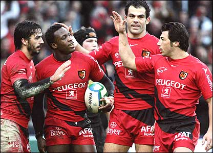 Wing Yves Donguy (second left) is congratulated by Toulouse team-mates after scoring their fourth try