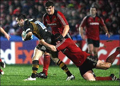 Wasps wing David Doherty is tackled by Munster flanker Denis Leamy
