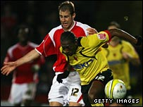 Lloyd Doyley holds off Charlton's Luke Varney 