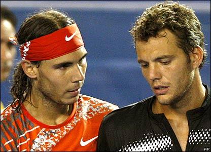 Rafael Nadal consoles Paul-Henri Mathieu