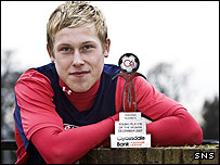 Falkirk midfielder Scott Arfield shows off his award