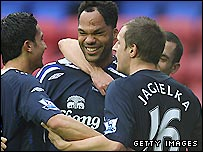 Everton players congratulate Joleon Lescott (centre) after he puts his side 2-0 up at Wigan