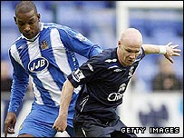 Wigan defender Titus Bramble (left) made the mistake to let in Everton striker Andrew Johnson