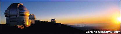 Gemini North Observatory at sunset.  The United Kingdom Infrared Telescope is centered. (Gemini Observatory)