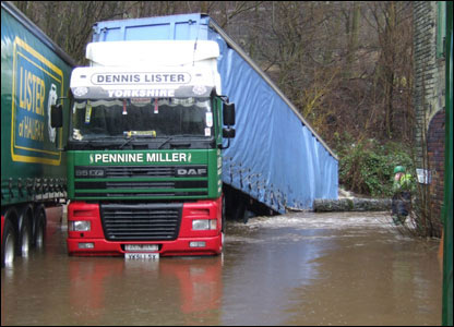 Photo taken by Howard Holmes of a lorry which reversed into a river in Hebden Bridge