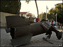 The remains of a rocket reportedly fired from Gaza lie in a street in Sderot, Israel