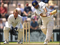 Adi Aymes watches Sachin Tendulkar bat for India at the Rose Bowl in 2002