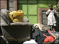 A young girl in a Nairobi slum waits for police to escort her family to safety on Monday 21 January 2008